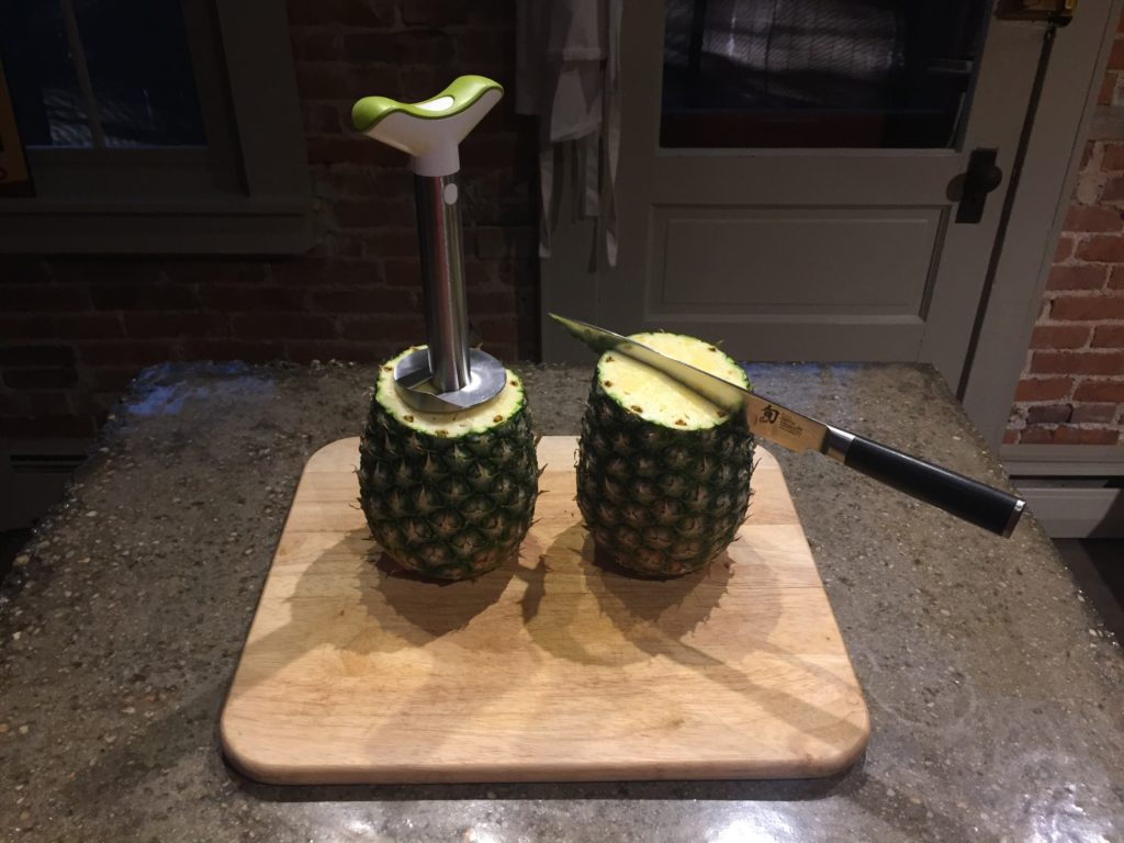 Take the tops off the pineapple
